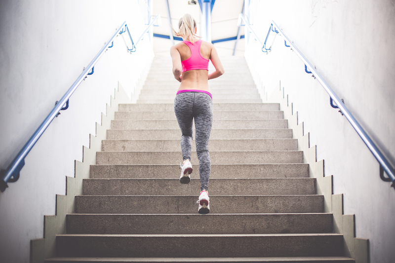 Young fitness girl running up the stairs picjumbo com